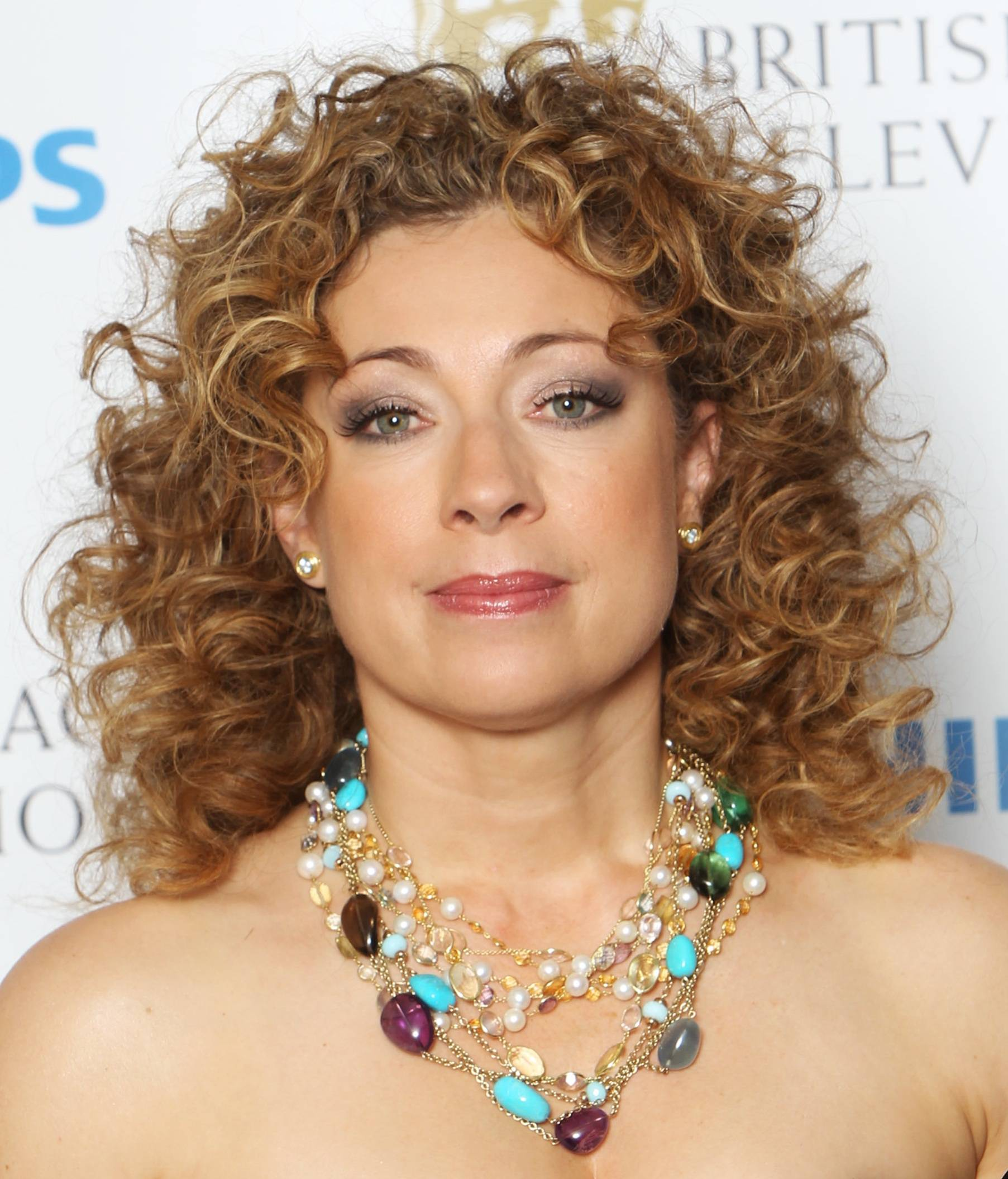 Alex Kingston Medium Length Curly Hairstyle Cool Curly