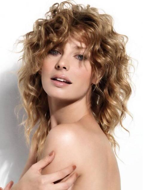 Medium Length Blonde Curly Hairstyle